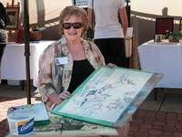 A water colour painter displays her project