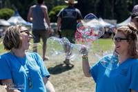 Volunteers having fun with bubbles
