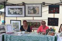 Director Wendy Harris (left) and friend exhibited their lovely artwork at the event