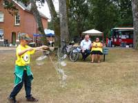 Kid with giant bubbles