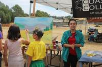 Director Laura Rechwan took charge of the Coast Collective public painting