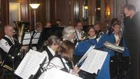 Members of the Westshore Community Concert Band played in the (overheated) gallery