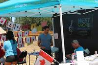 Our Canada Day booth. Kristi, Kyle and Bert